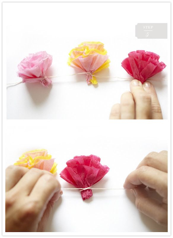I'm thinking about making strands of these in a yellow, white, and black color scheme but the flowers would be more spaced out to hang as garland from trees or in the tent or around the sides of the tables