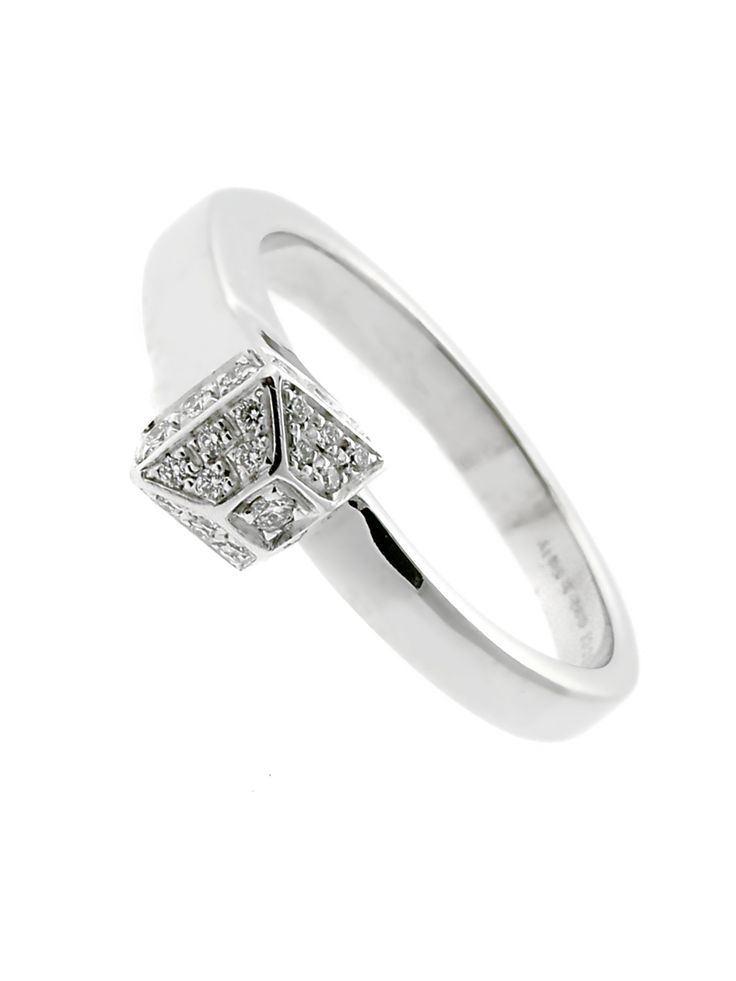 Featuring an impressive array of Vs1 E-F Color Diamonds (30, in fact), this Chiodo Diamond Ring from Gucci packs an incredible amount of radiance into a truly timeless design. The smooth White Gold band serves dutifully as a classic and tasteful counterpoint to the brilliance of the Diamond-laden crown, imbuing the Ring as a whole with a sense of visual balance which is quite simply irresistible.