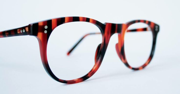 Custom-made frame with squared bridge in faux striped horn acetate, designed and produced by General Eyewear, handmade in England