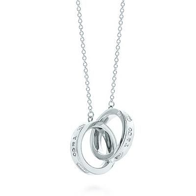 "A timeless Tiffany favorite. Interlocking circles pendant in genuine silver. Size small, on a 16"" chain."