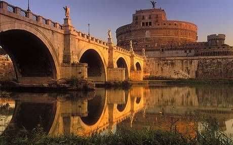 The towering Castel Sant'Angelo behind the River Tiber.
