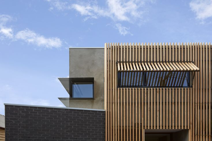 Timber, Brick and Rendered Concrete Facade