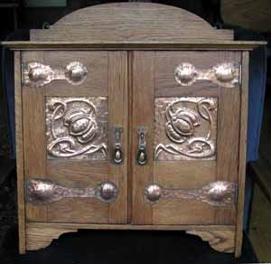 Oak Smokers Cabinet with copper panels and hinges. Shapland and Petter stamped number.