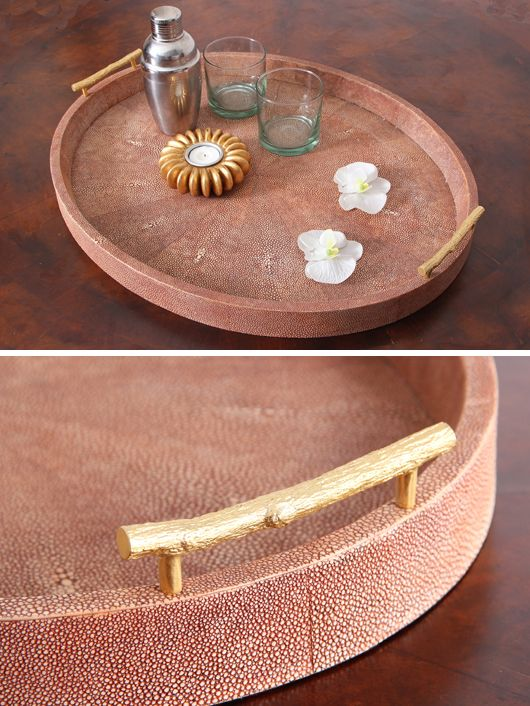 Shagreen Oval Tray - Coral. An old favorite, our faux shagreen drinks / serving tray with jungle twig stainless steel handles gold plated. The coral is a classic colour for shagreen. The trays are very practical and can be wiped clean with a damp cloth. No wine stains!