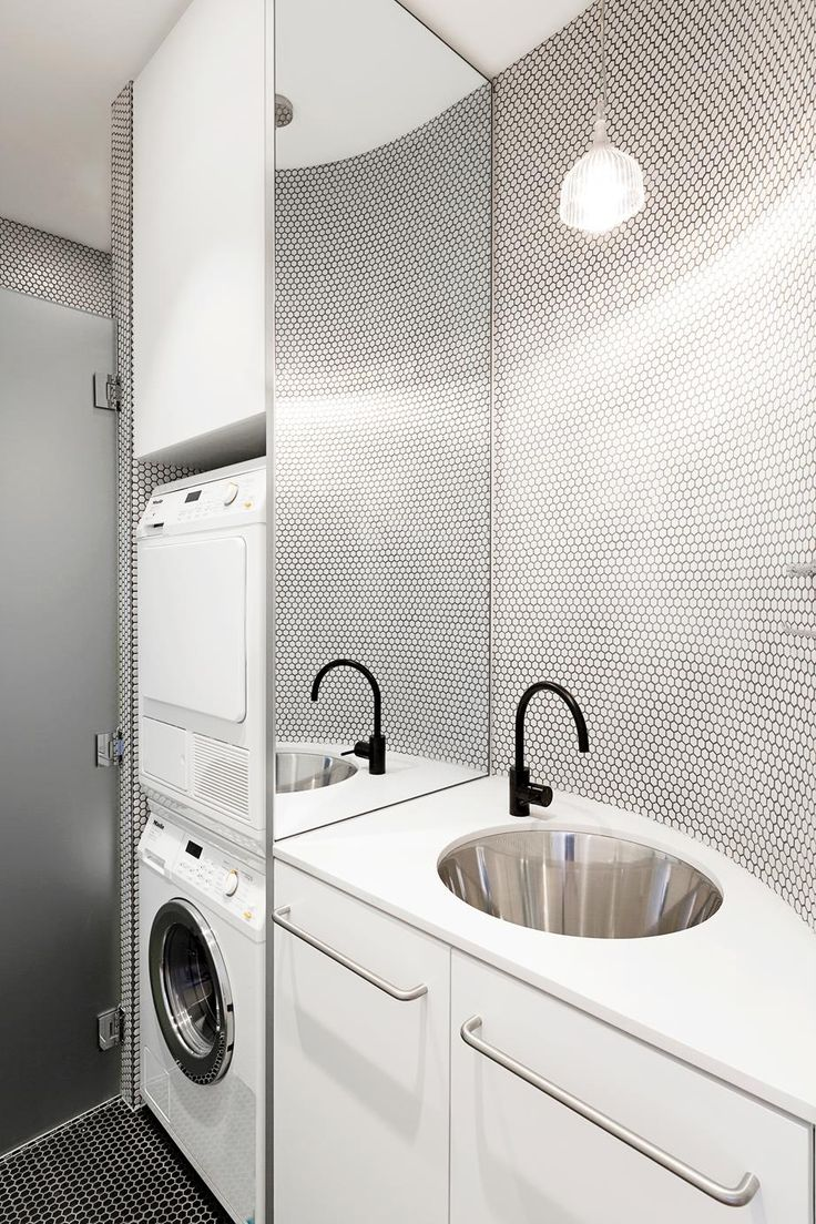 love the curved benchtop, tiling, mirror splashback, great use of space, black tap --- http://www.homestolove.com.au/perfect-laundries-time-to-think-outside-the-box-3410