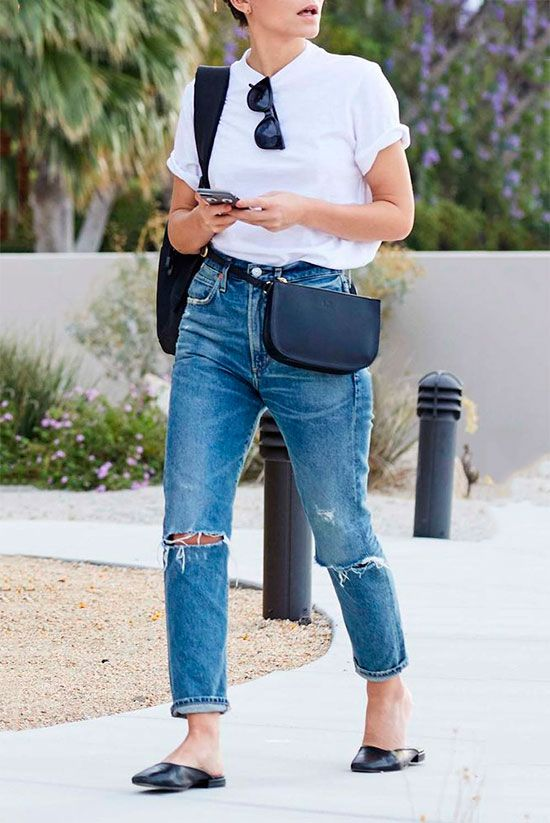 4ae1c74ec Sleek Ways To Style The Modern Fanny Pack: Woman wearing a white t-shirt,  distressed high waist jeans, black mule flats, black wayfarer sunglasses  and a ...