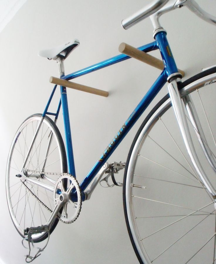 """""""Wooden Bike Hook"""": Love the minimalist approach to these oak posts! The metal supports are completely hidden....great for an """"in-home"""" display. Approximately $87.47 USD 