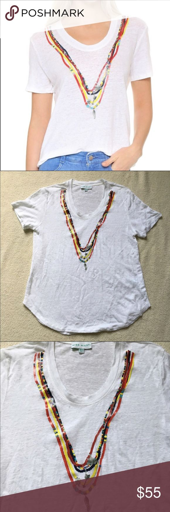 Mira Mikati Printed Bead Necklace Tee Mira Mikati Printed Bead Necklace Tee in size 4. Designer Mira Mikati co-owns the high-end Beirut boutique Plum, a curated collection of clothing that serves as a fashion mecca for the women of Lebanon. Photoreal necklace prints frame the scoop neckline on this linen Mira Mikati tee. Short sleeves. Semi-sheer. Curved hem. Excellent condition, US size 4.  Fabric: Linen jersey. 100% linen. Wash cold. Mira Mikati Tops Tees - Short Sleeve