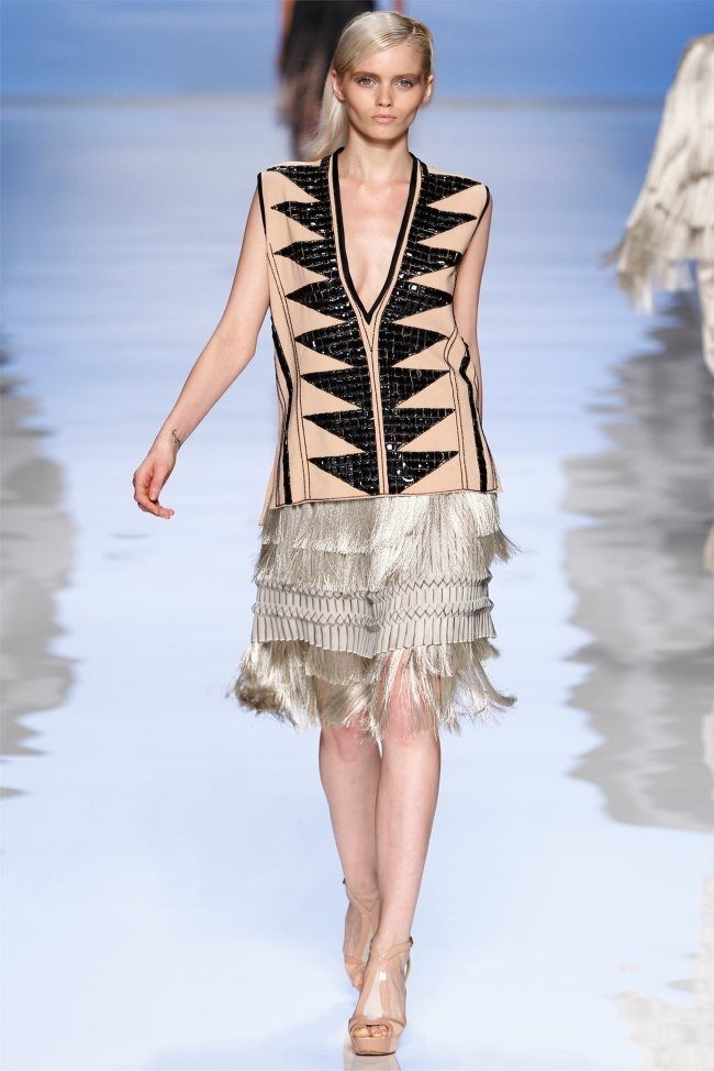 This look takes on 1920s silhouettes with skin-baring cut-outs for a more modern update of the classic flapper shape. One of the main flapper girl aspects is fringe which was very popular among women in the 1920s. 4/6/15