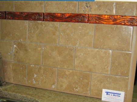 Cool Stone tiles with textured copper tile band at the top