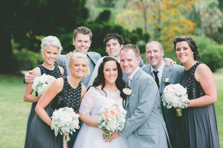The whole wedding party. Bride, bridesmaids, groom, groomsmen all showing off their fresh flowers from Florette - Flowers by Erin Cusack
