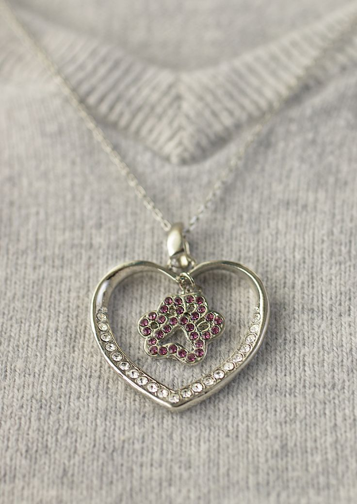 Let the heart sing with our dazzling crystal accented necklace. Featuring a crystal-frosted central dangling paw print, you send a sparkling message of love for your animal companions.