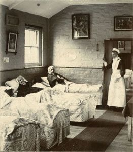 A Workhouse Infirmary with patients and nurse