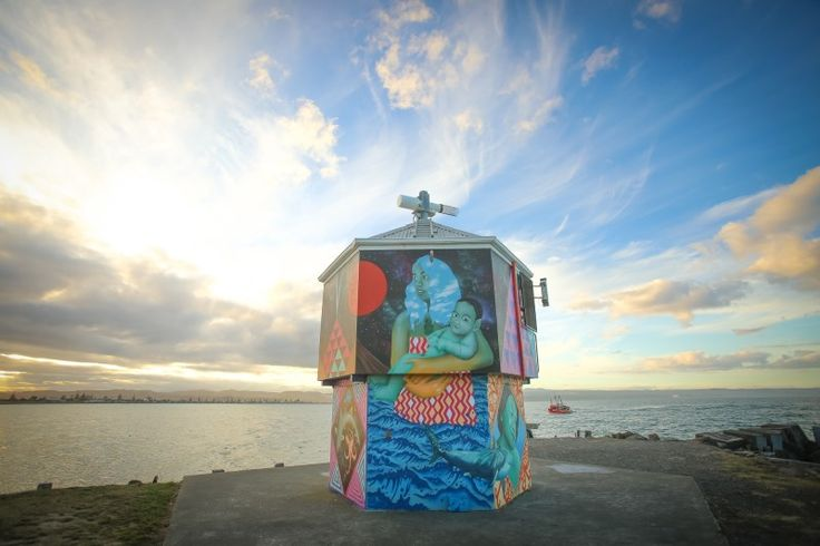 Aaron Glasson's completed mural on the lighthouse at Perfume Point, Ahuriri.