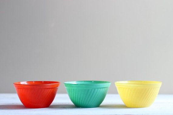 Fun mid century trio of colorful glass bowls. Maker unknown.  In good used vintage condition. Some scratches, paint chips, and stains.  Each measures 2.75H x 5.25W  Please contact with questions prior to purchase. Im happy to help
