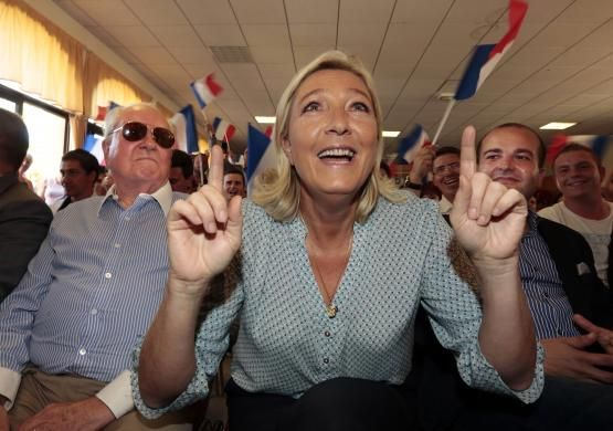 Marine Le Pen, France's National Front political party leader, gestures as she attends the Front National party's weekend summer university youth meeting with her father Jean Marie Le Pen and Frejus Mayor David Rachline in Frejus September 7, 2014. REUTERS/Eric Gaillard