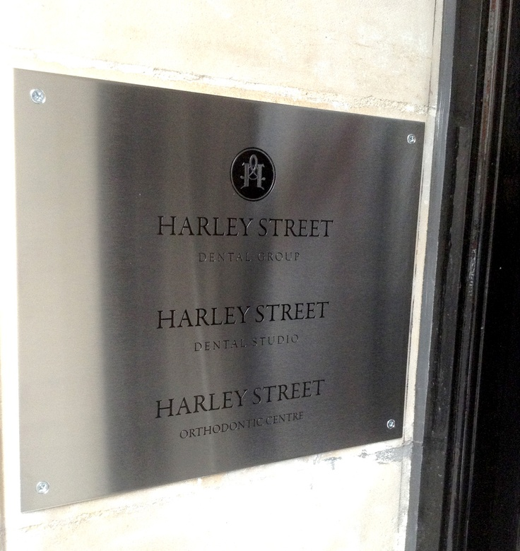 Brushed steel plaque designed by @sixredsquares for the Harley Street Dental Group.