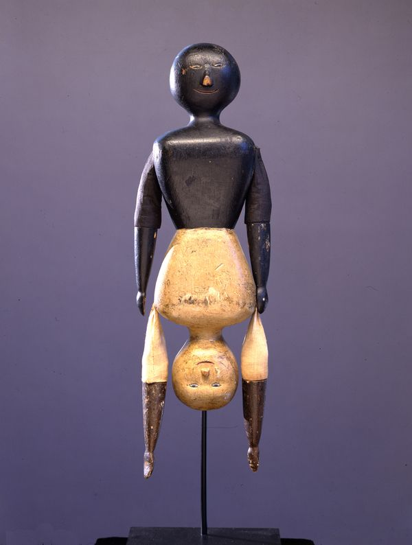 Fabulous carved wood topsy-turvy doll circa 1900.