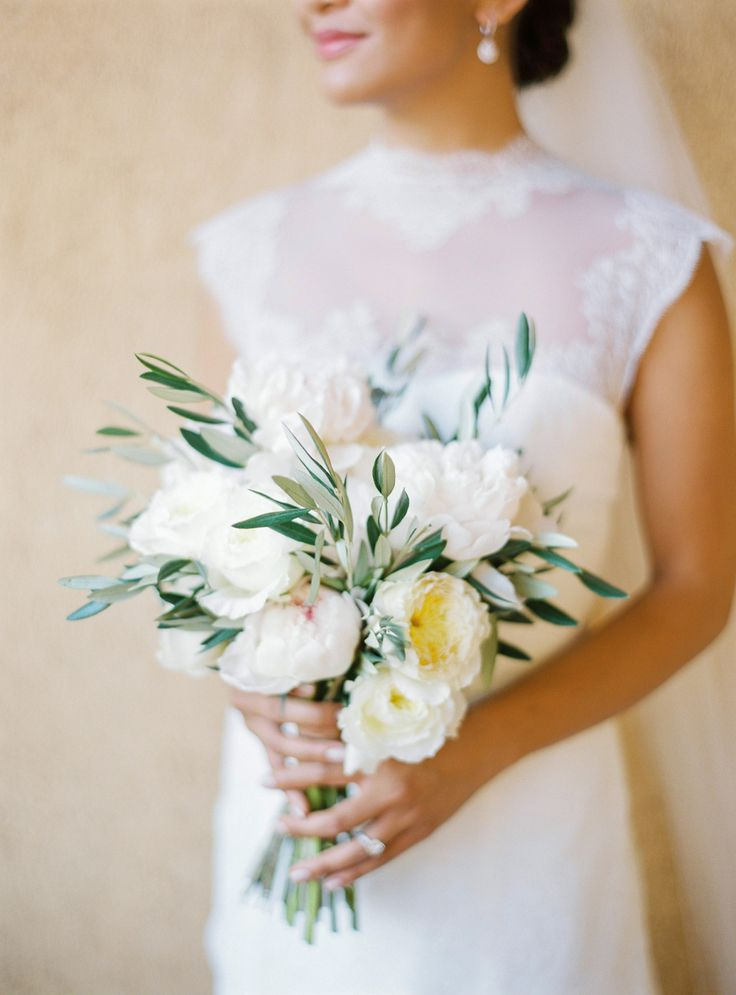 Peony and olive branch wedding bouquet: Floral Design: Of The Flowers - http://www.stylemepretty.com/portfolio/of-the-flowers Photography: André Teixeira, Brancoprata - www.brancoprata.com/   Read More on SMP: http://www.stylemepretty.com/2017/01/11/real-bride-inspired-by-grace-kelly/