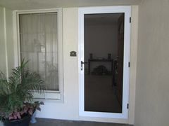 Guarda Security doors provide both security and a good looking front screen door for your home.