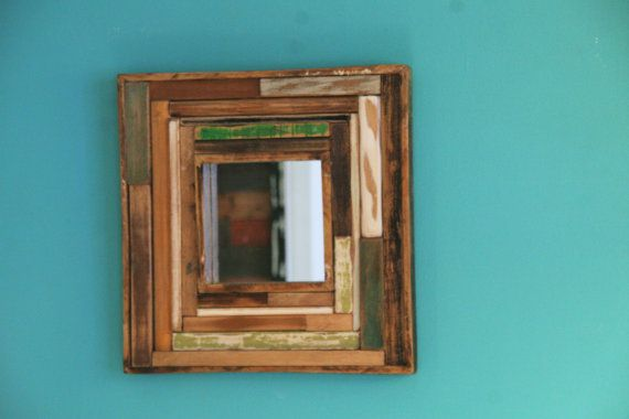 wooden mirror with pieces of reclaimed wood.