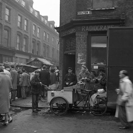 Busy street market near Brick Lane.