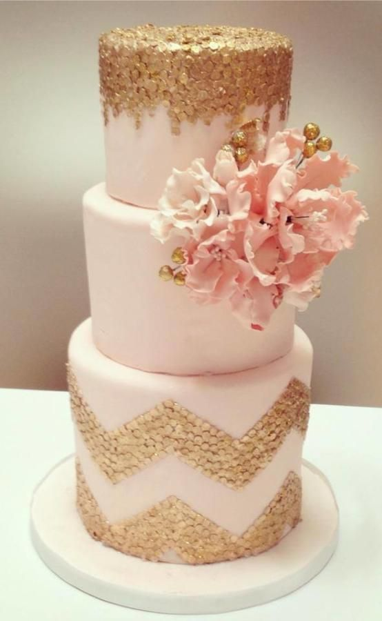 Light pink three tiered cake with edible gold confetti chevron and pink sugar flower