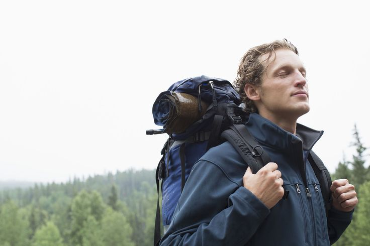 male backpacker breathing in fresh air with eyes closed by Hero Images on 500px
