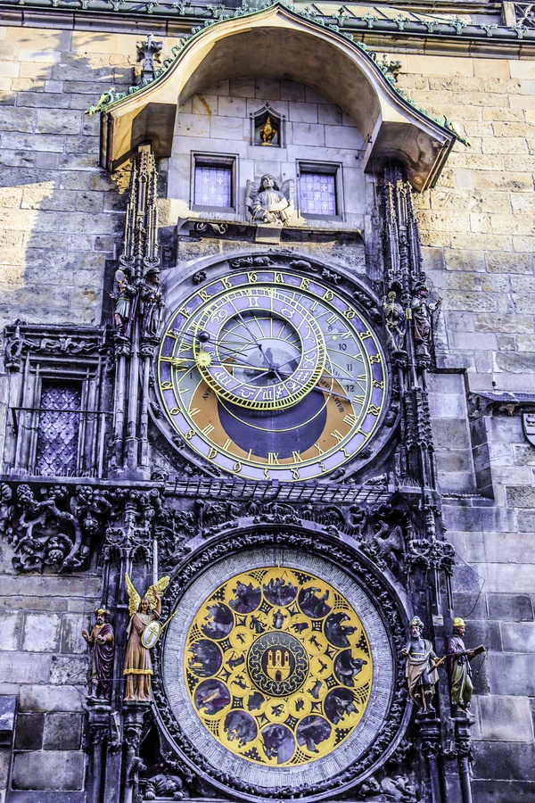~The medieval Astronomical Clock in Prague~ The medieval astronomical clock adorns the southern wall of the Old Town City Hall in the Old Town Square. It announces every hour with 12 apostles passing by the window above the astronomical dial and with symbolic sculptures moving aside.