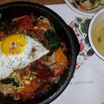 Bulgogi bibimbap, served in a dolsot. The rice is sizzling hot as they serve it! Gochuchang is | Yelp