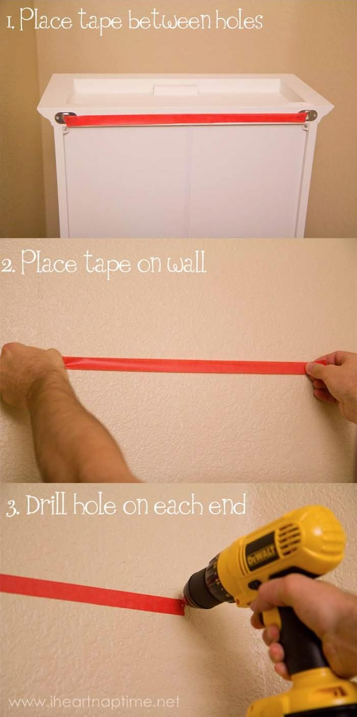 The Easiest Way to Hang a Picture Frame with paint tape. (I bought the tape, now just need to do it before Tyson gets home!)