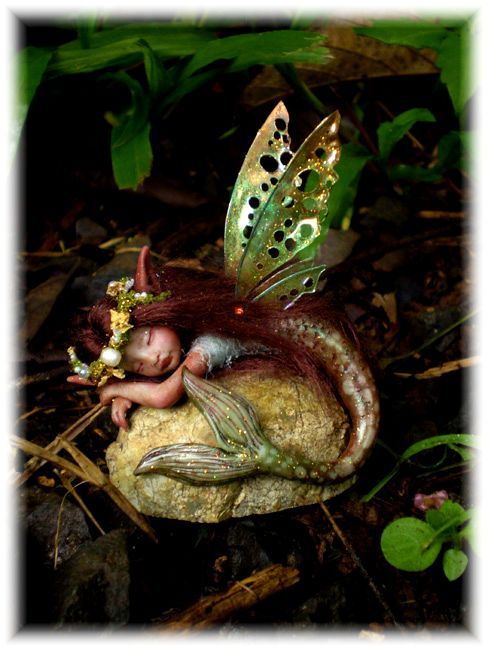 The Fantasy Works of Celia Harris.  So comfortable. Polymer clay mermaid!