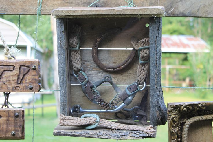 I made a rustic shadow box using a limb for the sides and old pallet wood for the back, top, and bottom.... The rest was stuff found in a horse barn....cost = free pallet, free limb, free stuff found in barn...total price = free