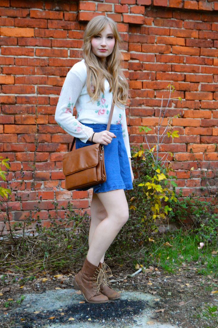 Vintage outfit with rose sweater, highwaisted skirt, combat boots. Fashion photoshoot.