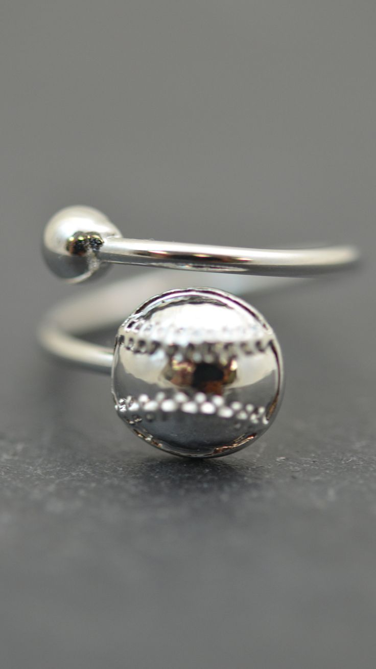 Propose to softball with this silver plated ring! A beautifully handcrafted softball with detailed stitching makes for a great softball gift for any player!