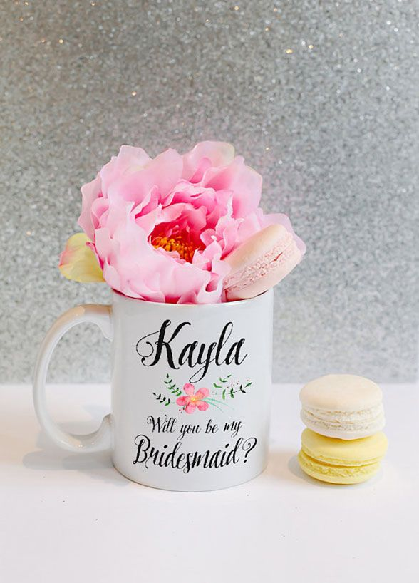 Bridesmaids Gifts Your Girls Will Actually Want: For girls who love their morning coffee, what could be better then a personalized mug? Your bridesmaid will love having a custom cup to drink out of while getting ready for your special day. With every sip after that, they'll fondly reflect on the fun memories of your wedding. Image courtesy of TheCraftyEngineerx