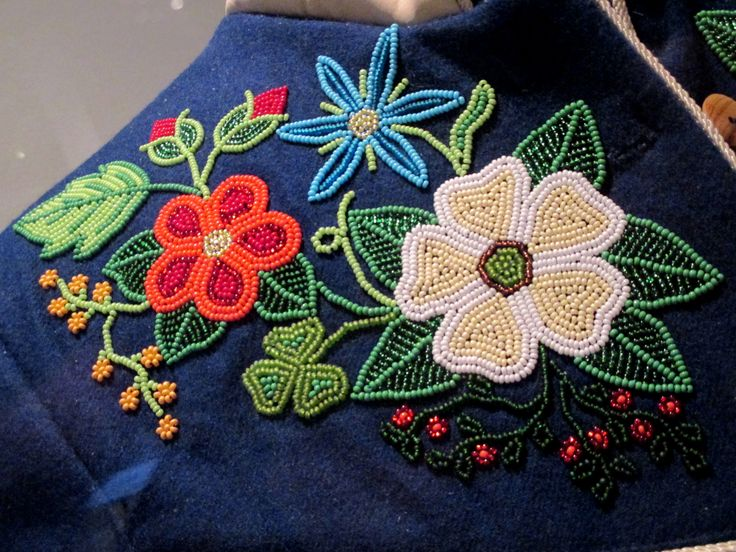 "2013 Métis (First Nations) Jacket (detail) at the McCord Museum, Montreal - From the curators' comments: ""Artist Briony Goddard made this hide jacket. Her designs, worked in vintage and contemporary glass beads, incorporate traditional floral elements, which she intersperses with plants and flowers found locally in the client's home region. The result is a new hybrid design - stunning evidence of the artist's flexibility."""