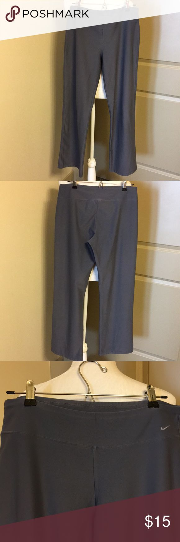 Nike yoga pant Basic dark grey Nike yoga or stretch pant. Slight flair to the bottoms and wide comfortable waistline that sits on the hips. They are in very good condition. Nike Pants Track Pants & Joggers