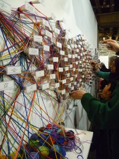 Identity Tapestry by Mary March. A paticipatory tapestry where participants map aspects of their identity creating this installation reflecting the complexity and interconnecting aspects of identity/ humanity.