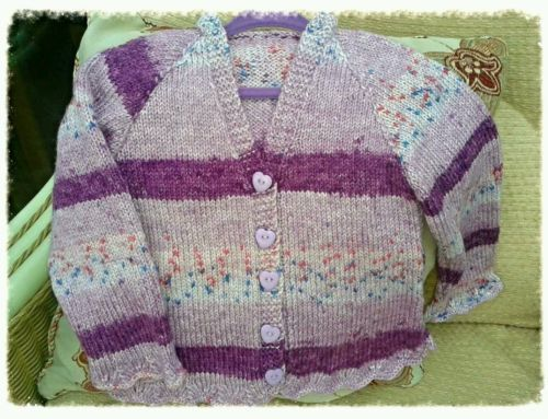 Hand knitted girls cardigan.