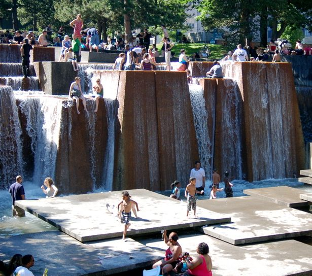Relief from the heat. People play in the Ira Keller's Civic Theatre Forecourt Fountain on a hot summer day. From the Portland Oregon Daily Photo blog. Photo by Olga Lynette Hanson.