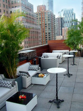 Overlooking the Hudson River & the skyscrapers of Times Square, the Attic Rooftop & Lounge opened in New York's Hell's Kitchen neighborhood in June. The bilevel venue covers 5,000 square feet, an indoor-outdoor rooftop space on the building's 16th floor that holds 450 guests & a glass-enclosed lounge on the 15th floor that holds 150. Each floor has its own bar & DJ booth. The design from Marc Dizon has a silver, grey & white color palette & incorporates banquette seating that could be