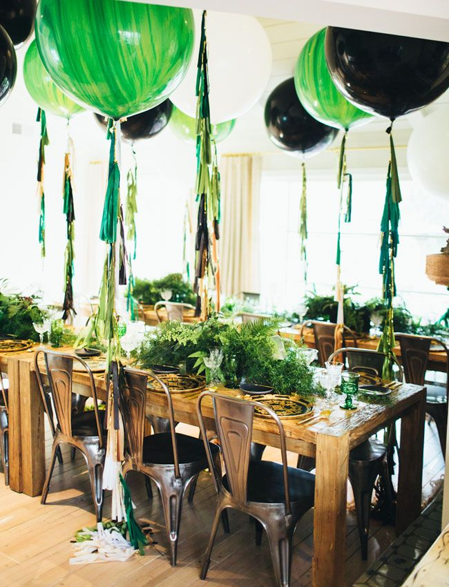 Vintage woodland birthday party with green + black balloons