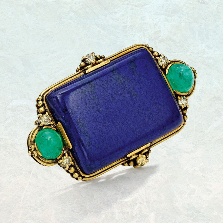 18-karat gold, lapis lazuli, emerald and coloured diamond brooch, Tiffany & Co., Designed by Louis Comfort Tiffany, 1915–1930.
