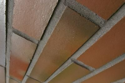 In traditional stone and brick installations, joints are mortared as the structure is built. Brick and stone veneer are installed more like tile, which requires filling the joints with mortar after the materials are set. Filling mortar joints in brick or stone is a different process than grouting tile. Because the surface is usually rough or uneven, grout floats wont work. Grout bags let you fill mortar joints individually, and with much more control over the mess that is usually associated…