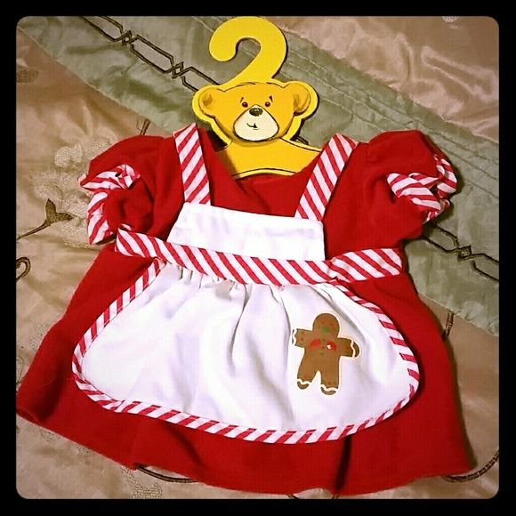 NWT Build-a-Bear Christmas Dress Adorable Mrs. Claus outfit from Build a Bear workshop, has candy cane red and white stripe trim and a cute picture of a gingerbread man on the apron, complete with hanger, fits most bears  Also on Mercari   Discount on 2+ item bundles! :-) Build-a-Bear Other