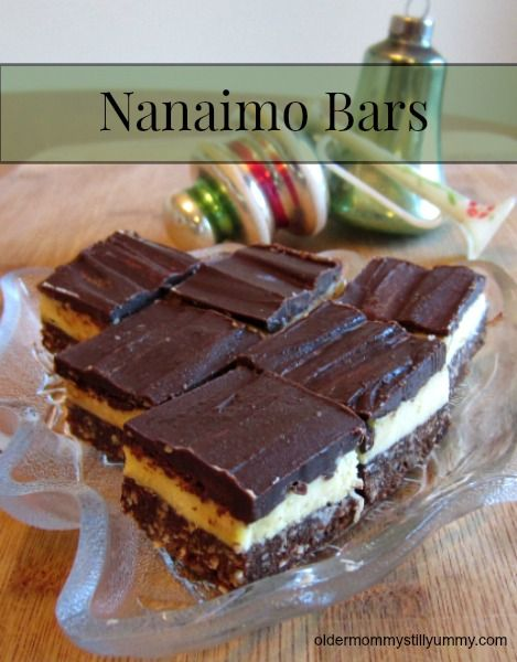 How to Make Nanaimo Bars ~ For those of you unfamiliar with Nanaimo Bars, you don't know what you are missing! These little cubes of deliciousness are a no-bake square with a Canadian origin and named after the west coast city of Nanaimo, British Columbia.