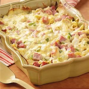 "Ham and Swiss Casserole Recipe -""When I prepare this noodle casserole for church gatherings, it's always a hit,"" writes Doris Barb from El Dorado, Kansas. ""It can easily be doubled or tripled for a crowd."""