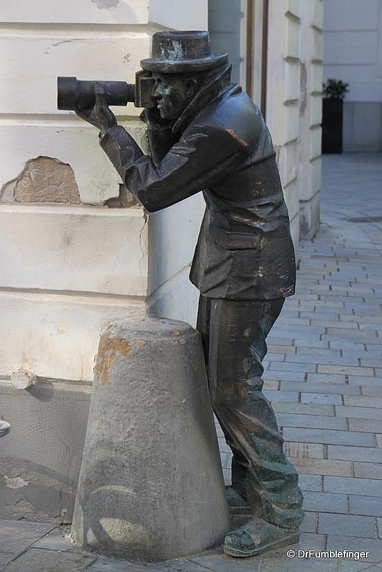 #http://www.TravelPod.com - Bratislava -- Street Art by TravelPod member Drfumblefinger, from Bratislava, Slovakia ... Nope, it's not me holding that camera.  # We cover the world over 220 countries, 26 languages and 120 currencies Hotel and Flight deals.guarantee the best price multicityworldtravel.com
