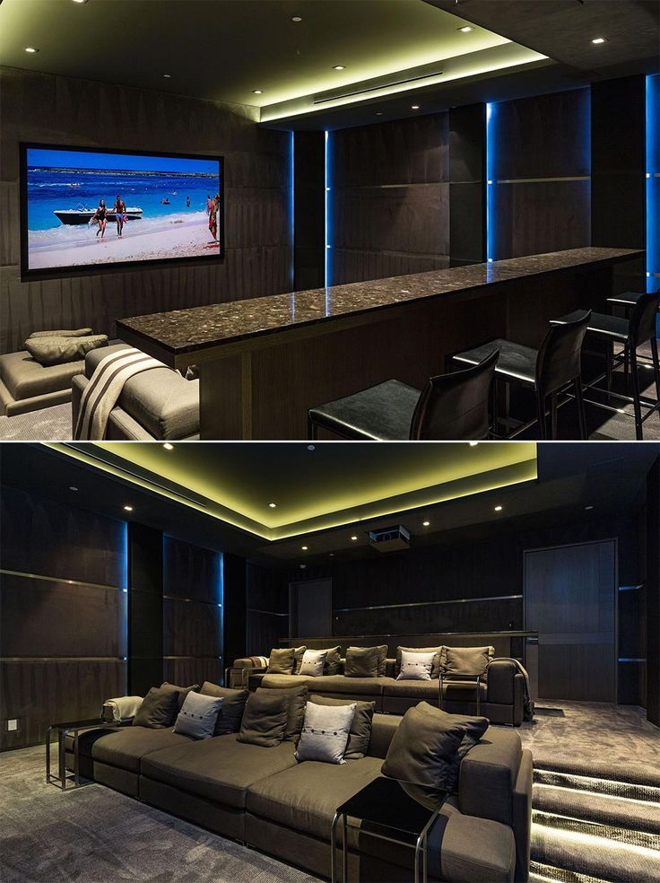 Luxury Home Theater with custom marble bar. A perfect screening room.